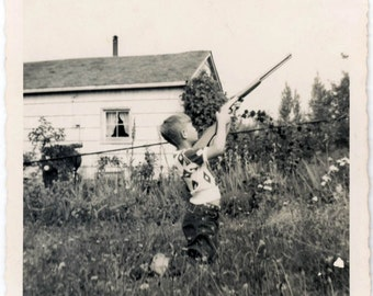 vintage photo 1950 Shooter Little Boy Aims Rifle into the Sky Air Gun