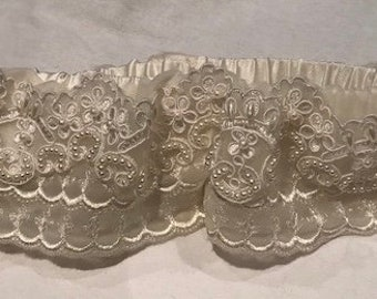 Lacey ivory bridal garter.