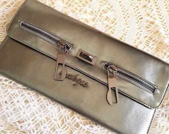 Silver purse, clutch, lots of pockets