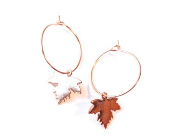 Rose gold hoop earrings, with maple leaf charms