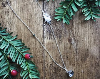 Long silver necklace with sterling silver leaf, tourmaline and acorn