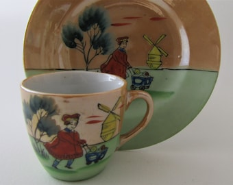 Child's lustreware hand painted cup and saucer.