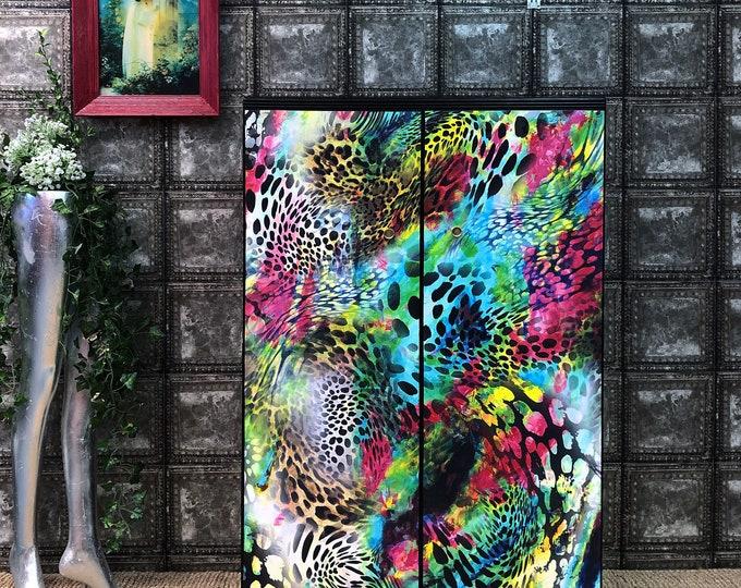 Multi coloured leopard tallboy wardrobe