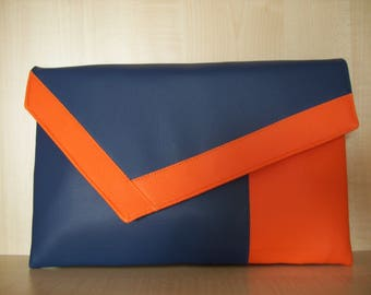 Over sized orange and royal blue asymmetrical faux leather clutch bag.