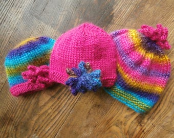 Colorful knitted baby caps
