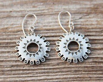 Silver Krimuldas Sun symbol earrings