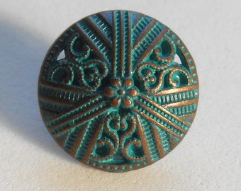 One 15mm Antique Copper Metal Alloy decorative button with openwork and a verdigris finish C0411