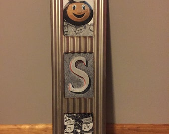 """Framed Ohio State """"OSU"""" with letters taken from Columbus"""