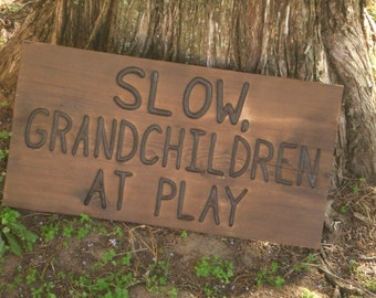 CUSTOM wood  Slow Grandchildren at play sign -- hand carved -- rustic un painted --  on reclaimed western cedar