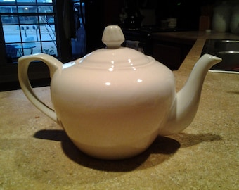Custom hand-illustrated ceramic teapots made to order
