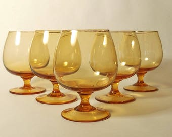 Five antique amber colored glasses
