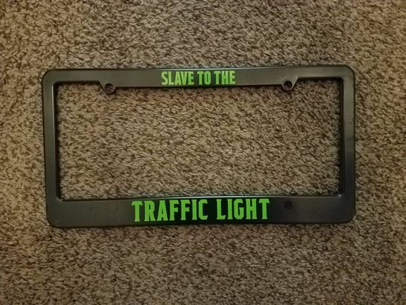 Slave To The Traffic Light License Plate Frame