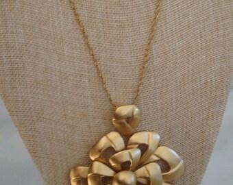 Vintage Crown Trifari Brushed Goldtone Dimensional Bow Pendant  Medallion Necklace