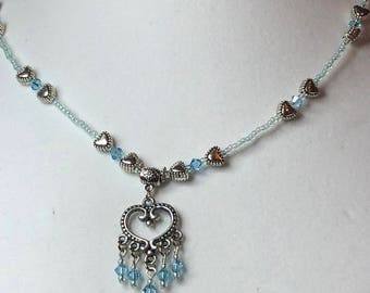 Blue crystal hearts necklace.