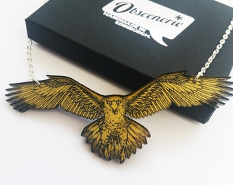 Golden Eagle Necklace in gold backed clear acrylic