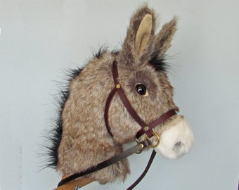 Child's Hobby horse (stick horse) Donkey. Top quality plush fur fabric with hardwood pole, wheels and leather bridle with bell. Ages 1-4