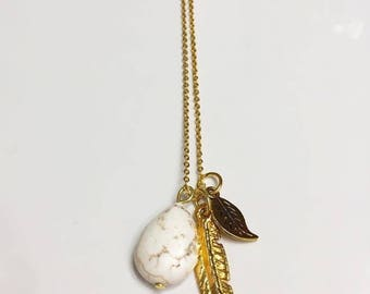 Golden feathers necklace