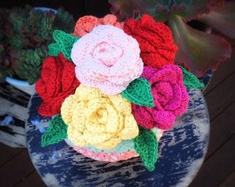 Crochet flower bouquet in crochet basket