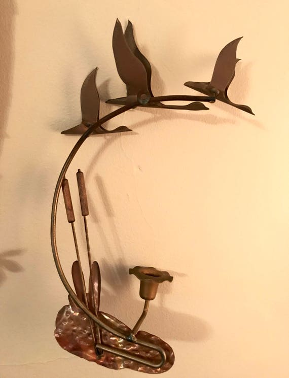 Brass and copper flying geese wall sculpture