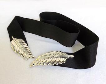 Black elastic waist belt. Silver leaf buckle. Wide dress belt.