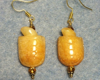 Yellow jadeite gemstone turtle bead earrings adorned with topaz Chinese crystal beads.