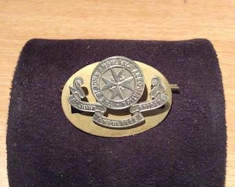 Cap badge for the British St Johns Ambulance Brigade