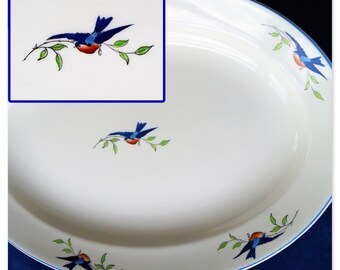 A large antique oval china platter featuring handpainted blue birds, made by WH Grindley c1914. Perfect for an elegant dinner party!