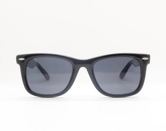 Black wayfarer style vintage sunglasses. Original 80s NOS. All time classic design in quality materials and finish. Made in Italy. BNWT.