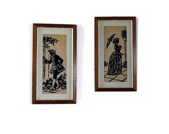 Vintage framed cross stit emboroidery. Regency Jane austen man and woman silhouettes.