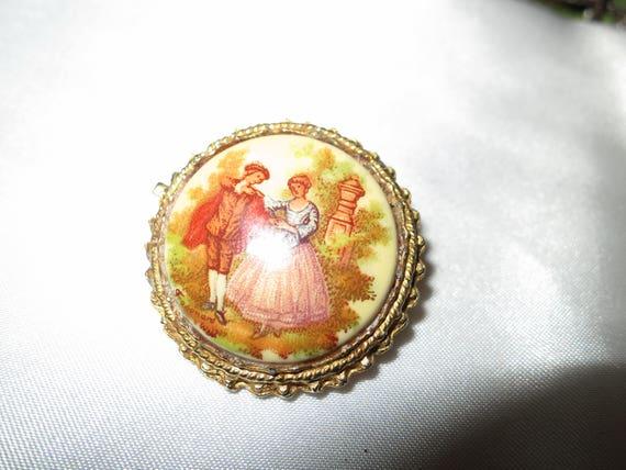 Lovely vintage Fragonard style romantic scene brooch