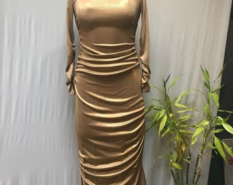 Gorgeous gold lame dress with assymetrical ruching details. Bodycon, 80's, 90's dress.