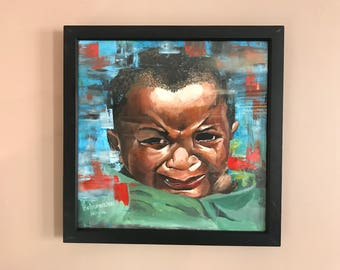 Framed painting of a crying child