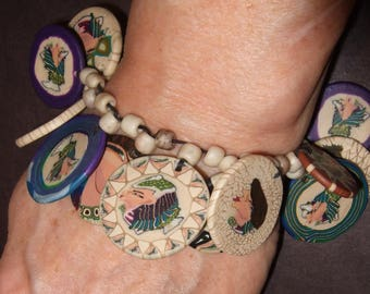 """Bracelet, Egypt/Cleopatra theme, polymer clay disks with Japanese tile bead spacers on waxed linen fits 7"""" wrist perfectly."""