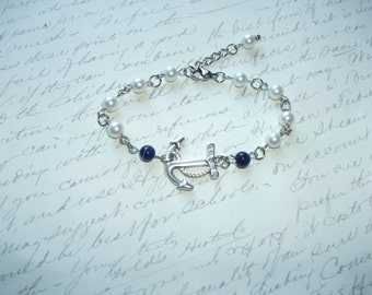 Anchor bracelet with white pearls and navy blue cat eye beads