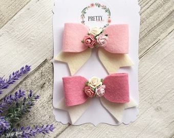 bow with mulberry paper flower centre. Tails down. Clip/ headband. Girls/ baby/ newborn sizes.
