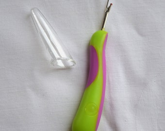 Seam ripper with ergonomically shaped handle