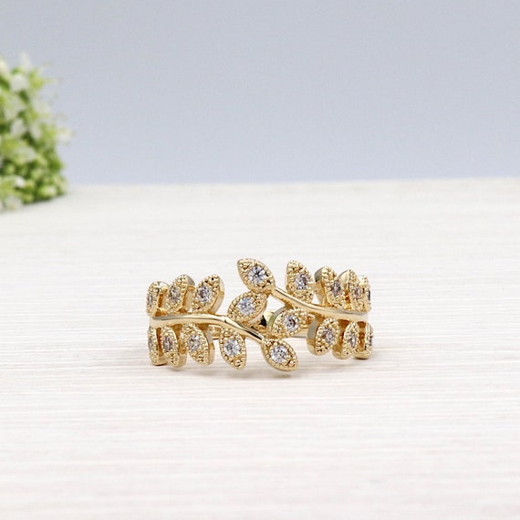 750 thousandth 3 Micron gold plated spikes and zircon stone set ring