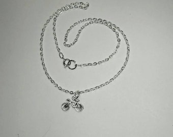 Sterling silver necklace with a bicycle pendant.