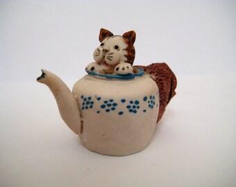Cat in a Teapot