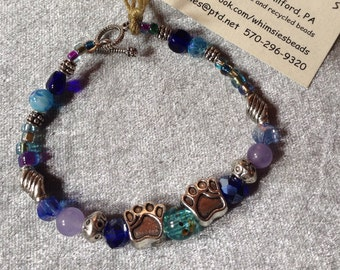 Glass beaded bracelet, size SMALL. Blue mix. Silver findings, dog or cat paws, Boho, hippie, fair trade, gift, free shipping. Made in USA
