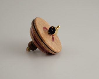 A spinning we will go... Wooden top designed by Martin Fischer.