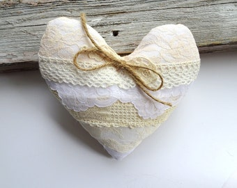 Farmhouse ring pillow with vintage laces in ivory and white with a burlap backing