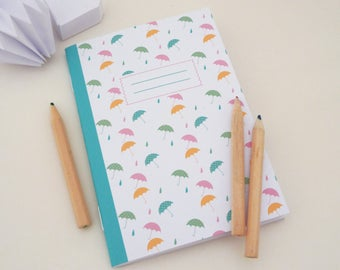 Illustrated notebook A6 of small colorful umbrellas