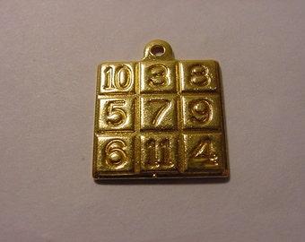 Vintage Gold Tone Metal Bingo Card Pendant   2011 - 1113