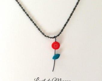 red flower pendant, gun metal chain