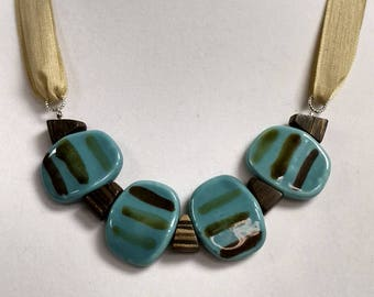 Aqua oblong beads with painted stripes...