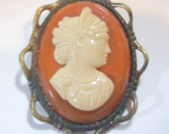 Older Cream Cameo on Composition Catnelian Base Brooch