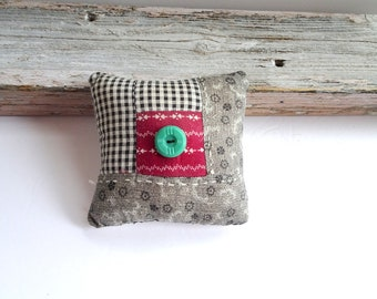 Pincushion made from primitive vintage quilt