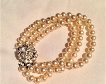 Pearl triple strand bracelet with rhinestone clasp