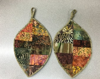 This is a pair of handmade leaf shaped potholders